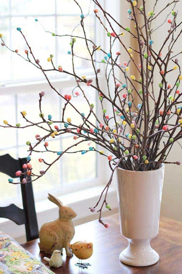 stick m&m to twigs and branches for a splendid easter centerpiece