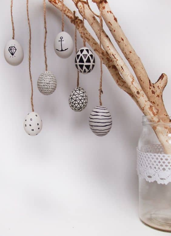 9. create a hanging egg decoration by using some basic rope and driftwood