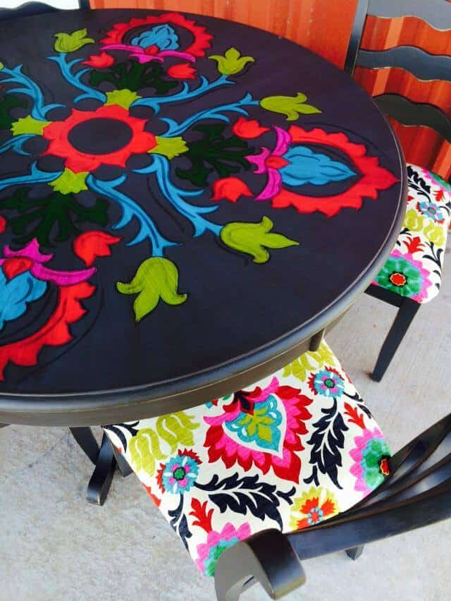 3. COLORFUL HAND-PAINTED SPOOL TABLE