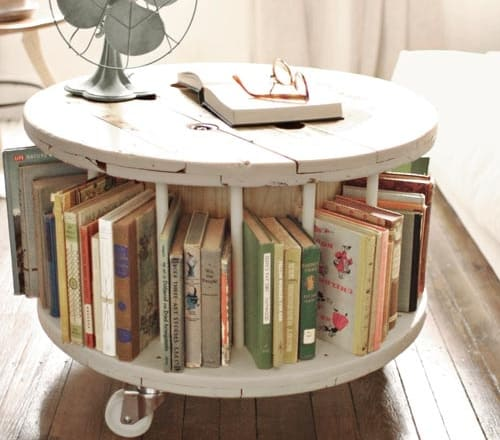 7. A Spool Table Serving As A Coffee Table/ Bookshelf