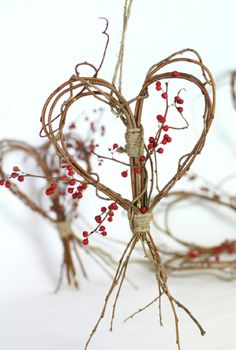 7. DELICATE TWIGS BENT INTO LOVING DECORATIONS