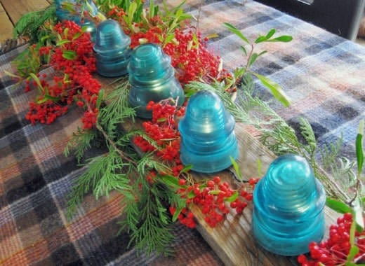 16. unique dinning table centerpiece with glass insulator lights