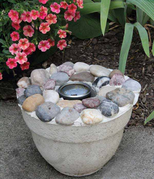 FLOWER-POT SHAPED CONCRETE AND RIVER ROCKS FIRE PIT