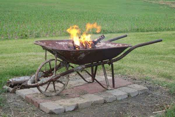 WHEEL BARROW USED AS A FIRE PIT