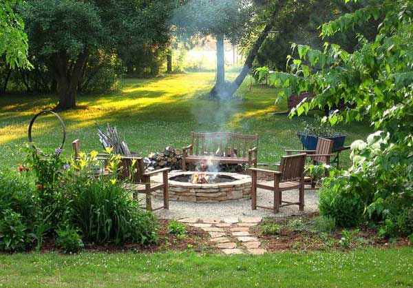 SERENE FIRE PIT AREA NESTLED IN AN OASIS OF VEGETATION