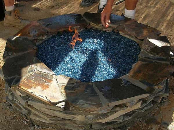 FIRE PIT DECORATED WITH BLUE GLASS