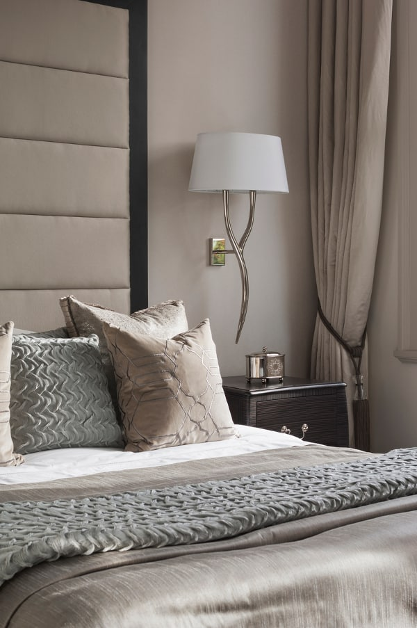 elegance aided by taupe colors in a luxurious bedroom design