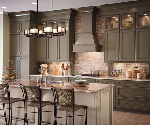 gray taupe contrasts with brick wall in the kitchen