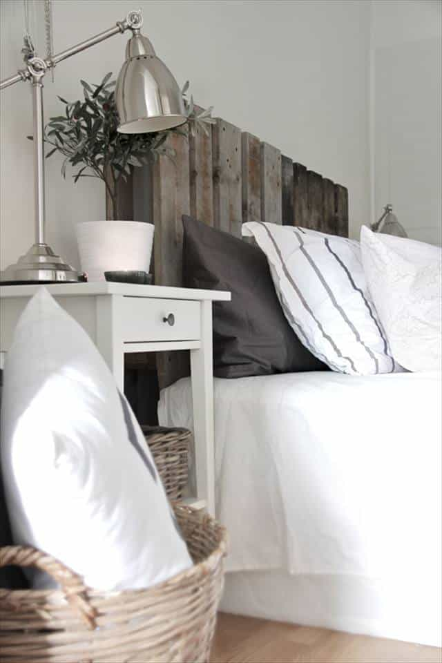 11. SCANDINAVIAN INFUSED BEDROOM DESIGN WITH A PALLET BED FRAME AT ITS CENTER