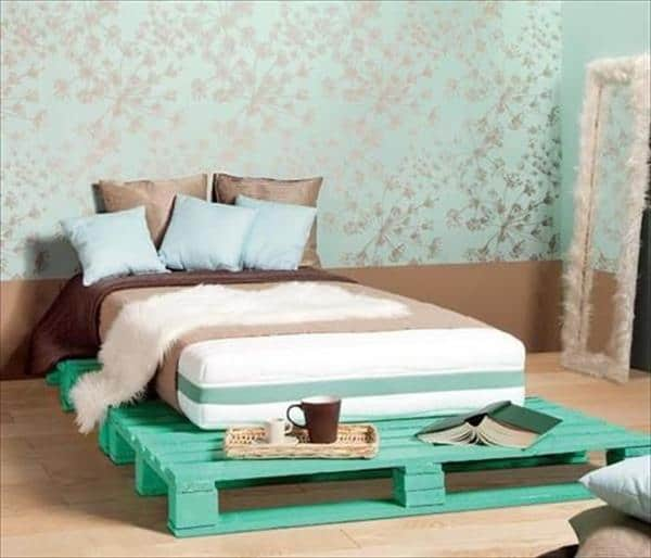 12. BRIGHT NEON GREEN PALLET BED ADORNED ON A GOLD AND GREEN WALLPAPER BACKGROUND