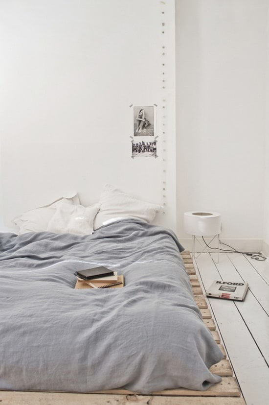15. A VERY LOW PALLET BED FRAME OFFERING COMFORT IN A MINIMAL DESIGN