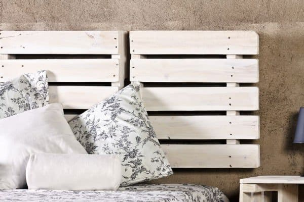 5.  WHITE PALLETS USED AS BED HEADBOARD