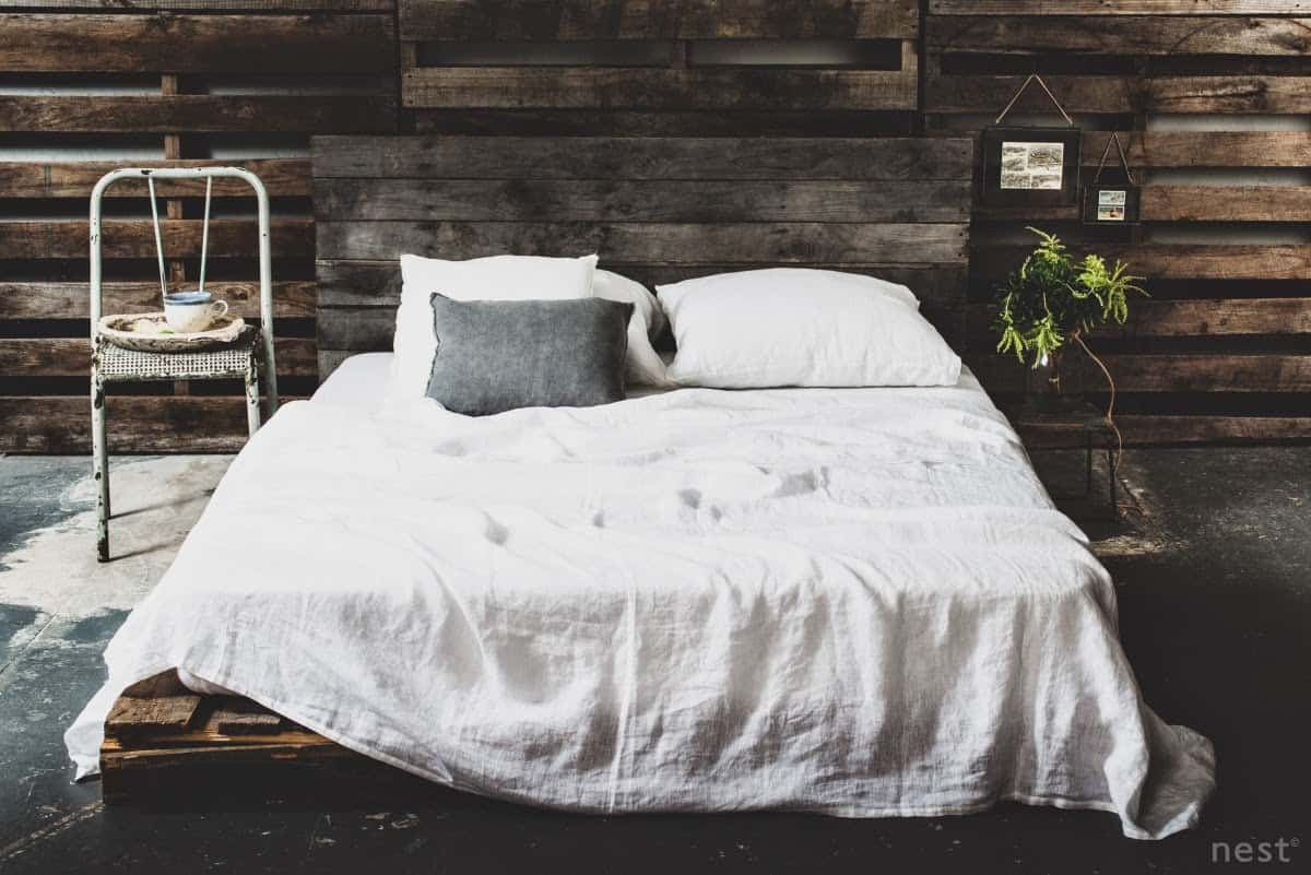 COZY DARK HUED BED FRAME IN A SIMILAR BACKGROUND DESIGN