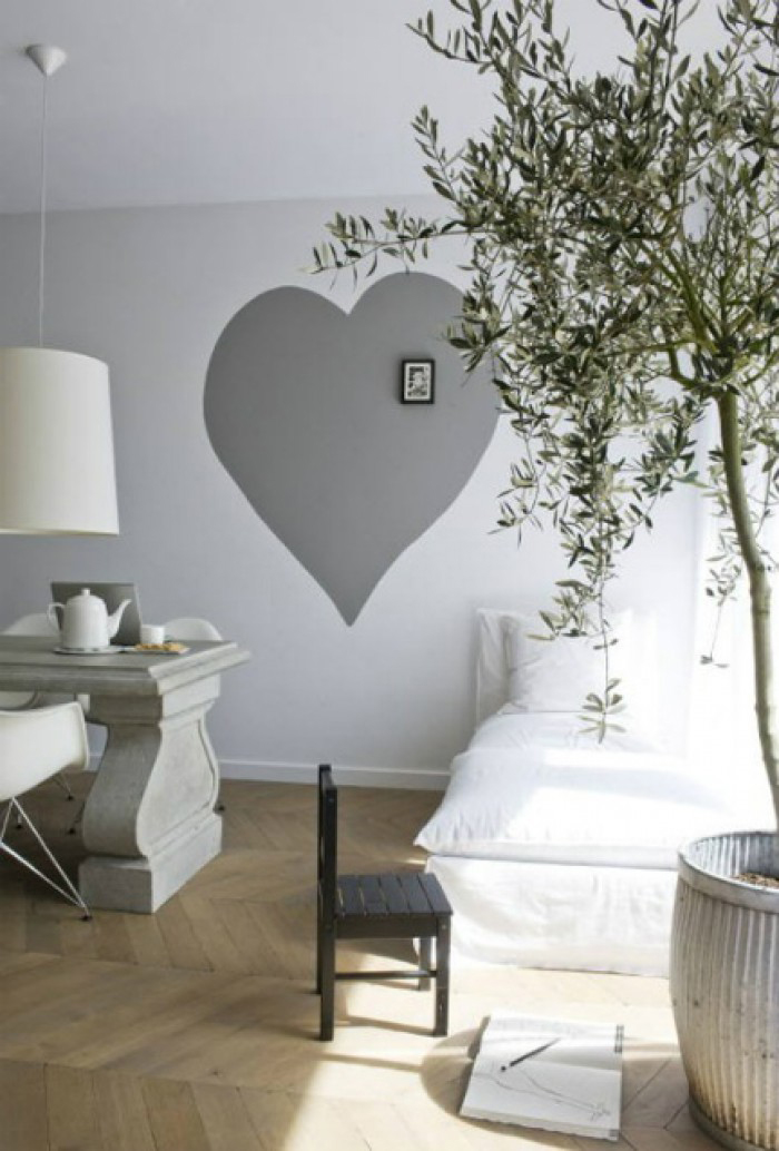 Neutral tones can be balanced with an olive tree