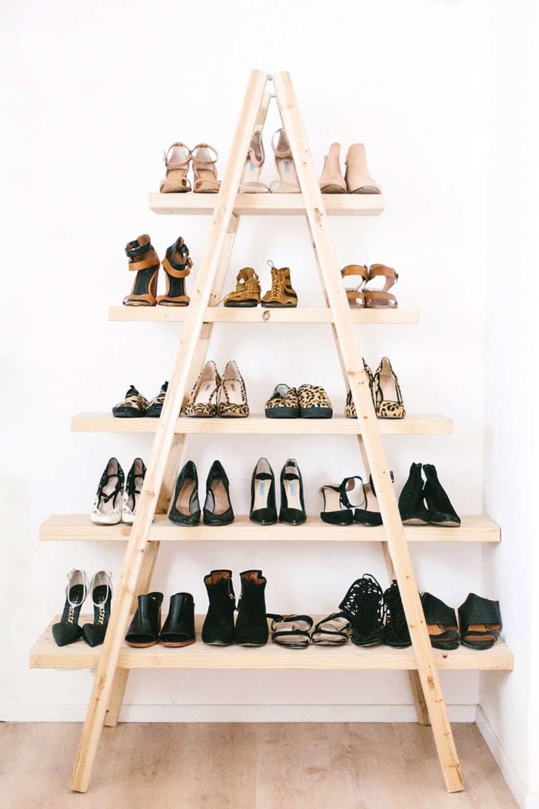USE A WOODEN LADDER TO STORE THE MOST NEEDED AND USED SHOES