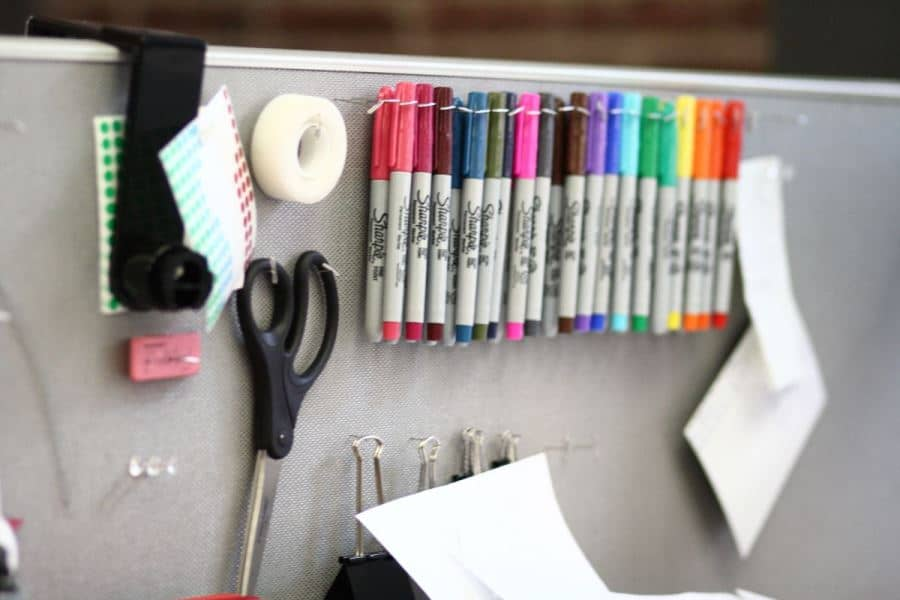 Everyday-office-supplies-on-a-cubicle-wall