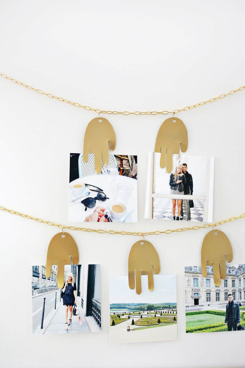 Metal-hand-photo-hanger-from-A-Beautiful-Mess