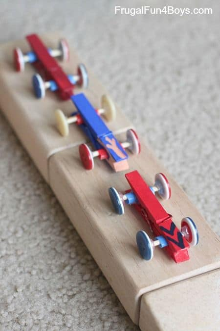 11. USE BUTTONS AND CLOTHESPINS IN RACE-CARS