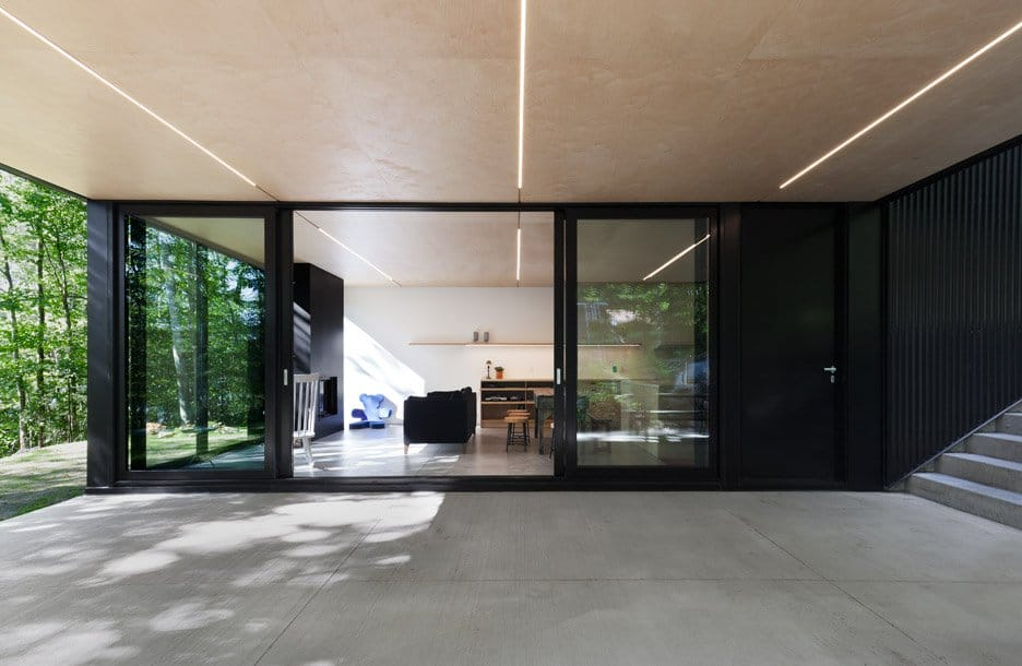 Impeccable Black Cottage in Quebec Forest by Jean Verville (7)