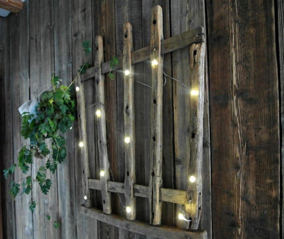 20. USE STRING LIGHTS ON A SIMPLE WOODEN STRUCTURE