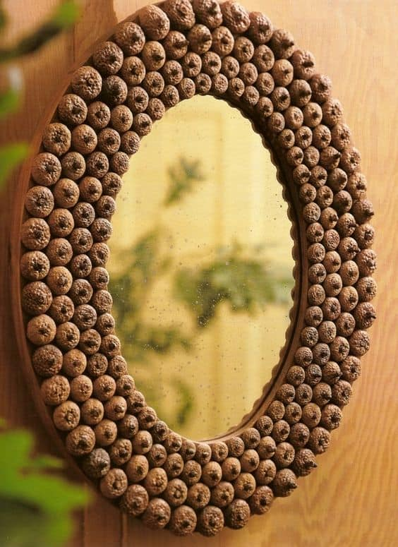 27. DECORATE A MIRROR WITH ACORNS
