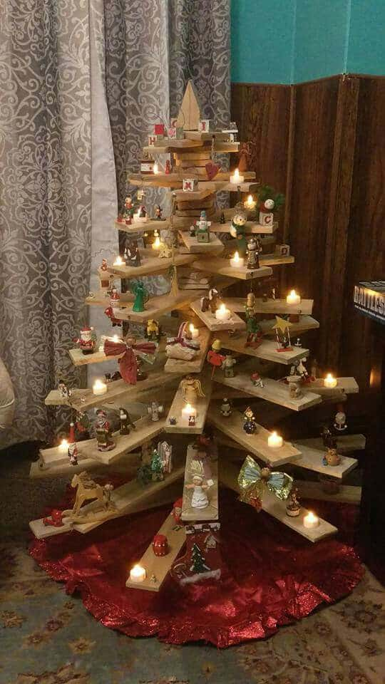 cute pallet tree holding multiple figurines