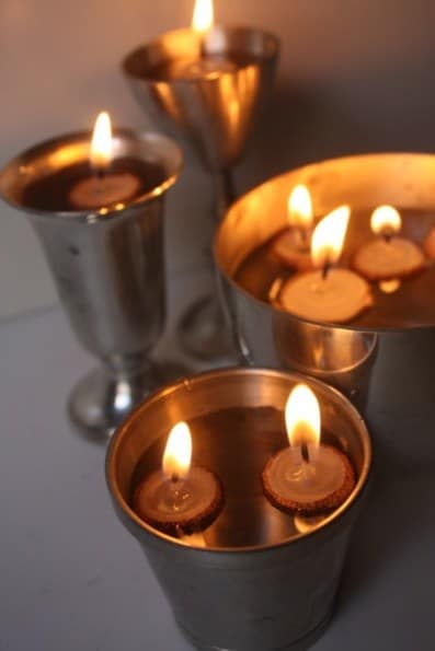 25. USE ACORN CAPS TO FORM FLOATING CANDLES