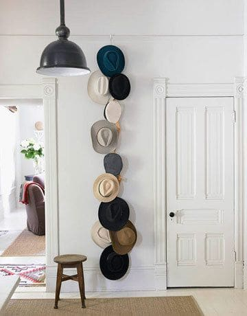 3. ACCENT THE WALL WITH HATS