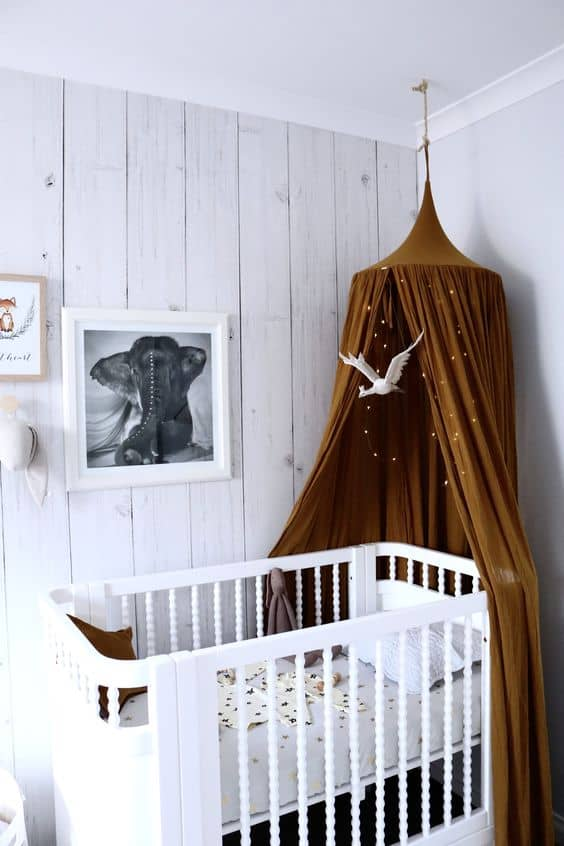 17. EARTHLY TONE AND FAIRY LIGHTS OVER CLASSIC CRIB