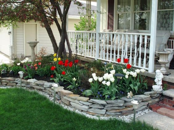 14. STONE SLABS EDGING AND STUNNING FLOWERS