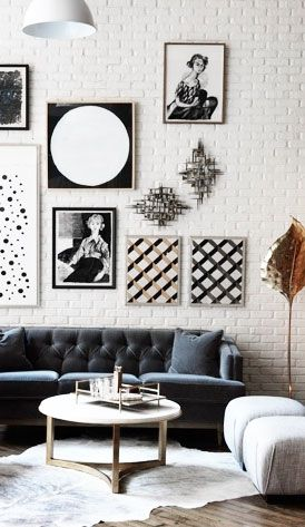timeless white brick wall with black and white picture frames