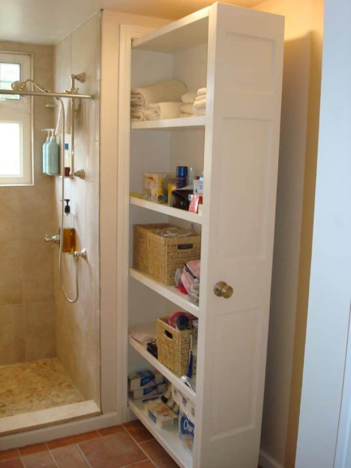 Cool hide a pull out tall drawer next to the shower area