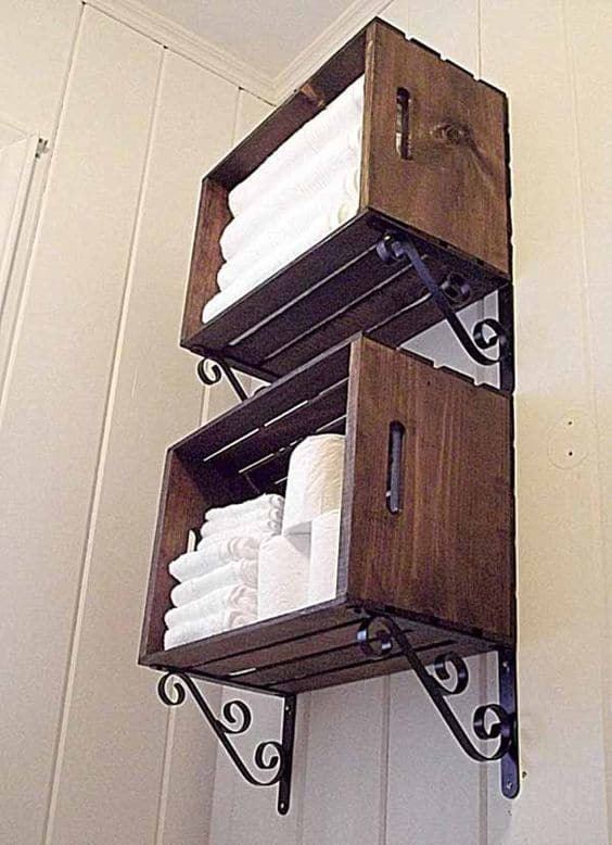 15. WALL MOUNTED CRATES AS BATHROOM SHELVES