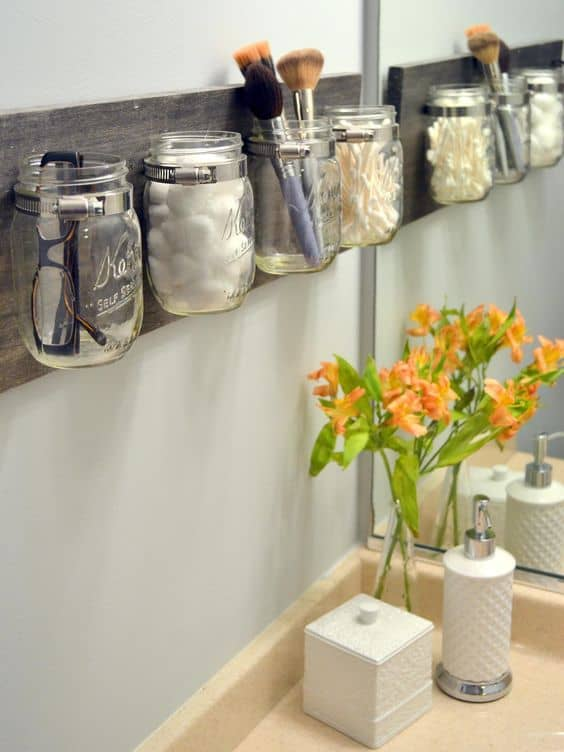 16. UNUSED JARS AS HOLDER FOR YOUR VANITY TABLE