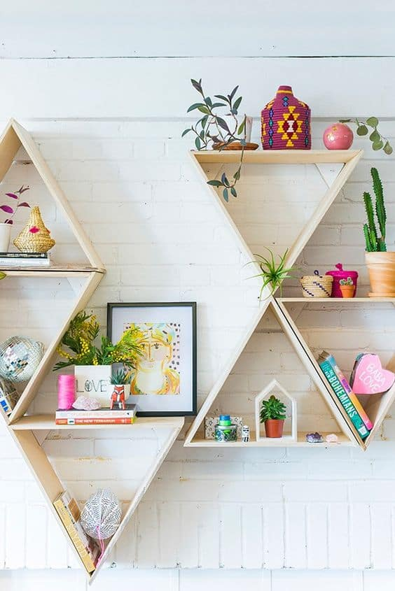 geometric wooden shelving on white brick wall