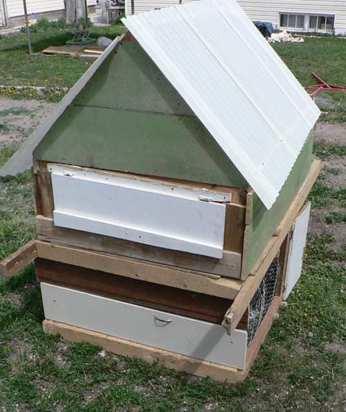 SALVAGED MATERIALS SHAPE CHICKEN SHELTER