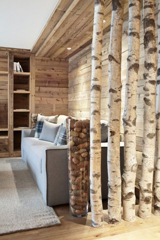 In The Same Expressive Form, Tree Bodies Separate The Couch Lateral Area  And Offer Shelter And Intimacy.