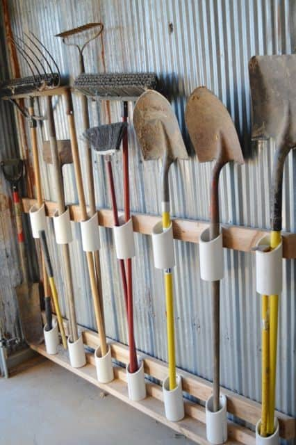 40. CUT PVC TUBES AS GARDEN TOOL ORGANIZERS IN THE GARAGE