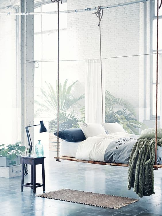 tranquility in bedroom with floating bed