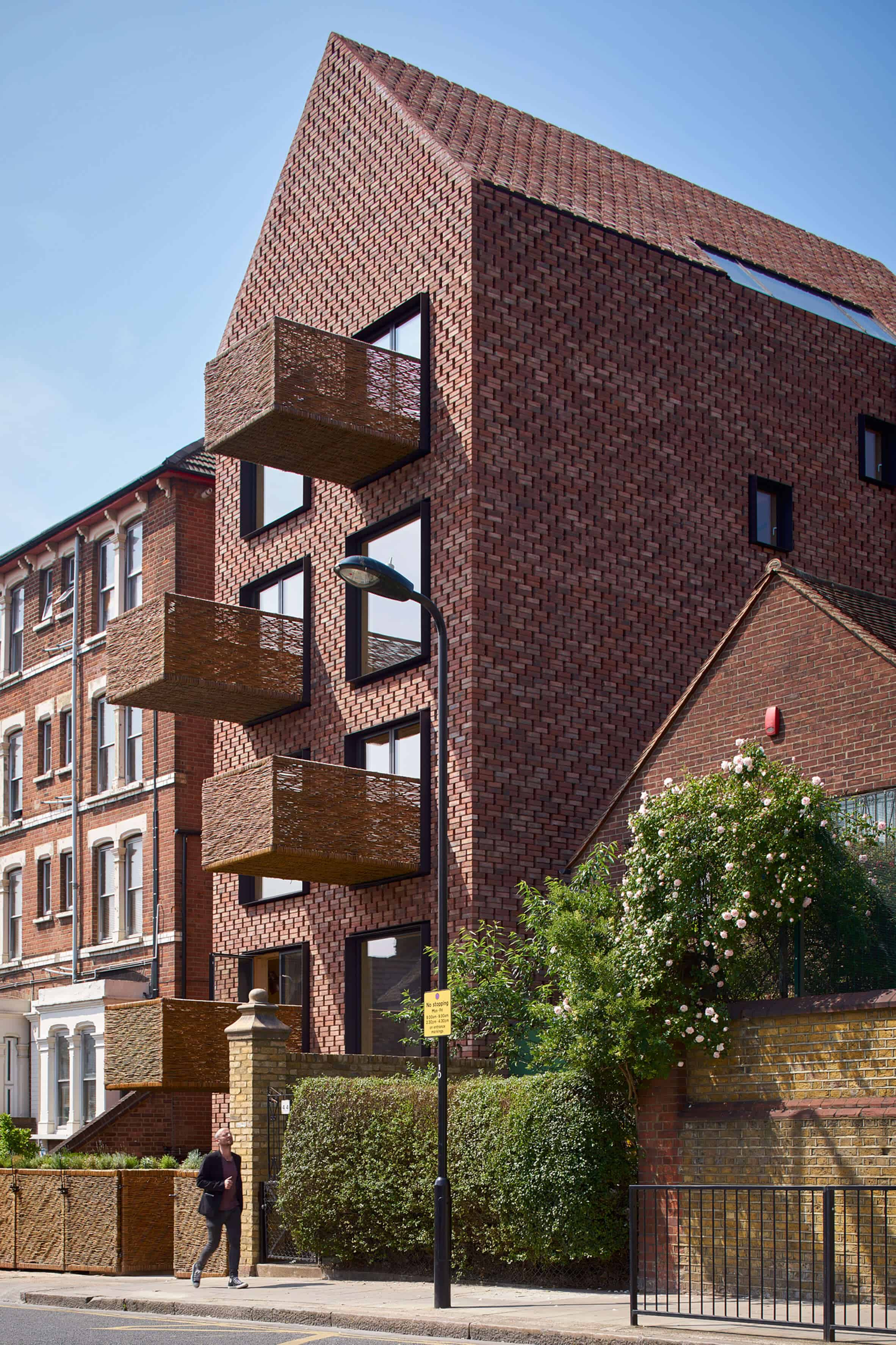 Cross Laminated Timber Wrapped in Brick by Amin Taha Architects 10