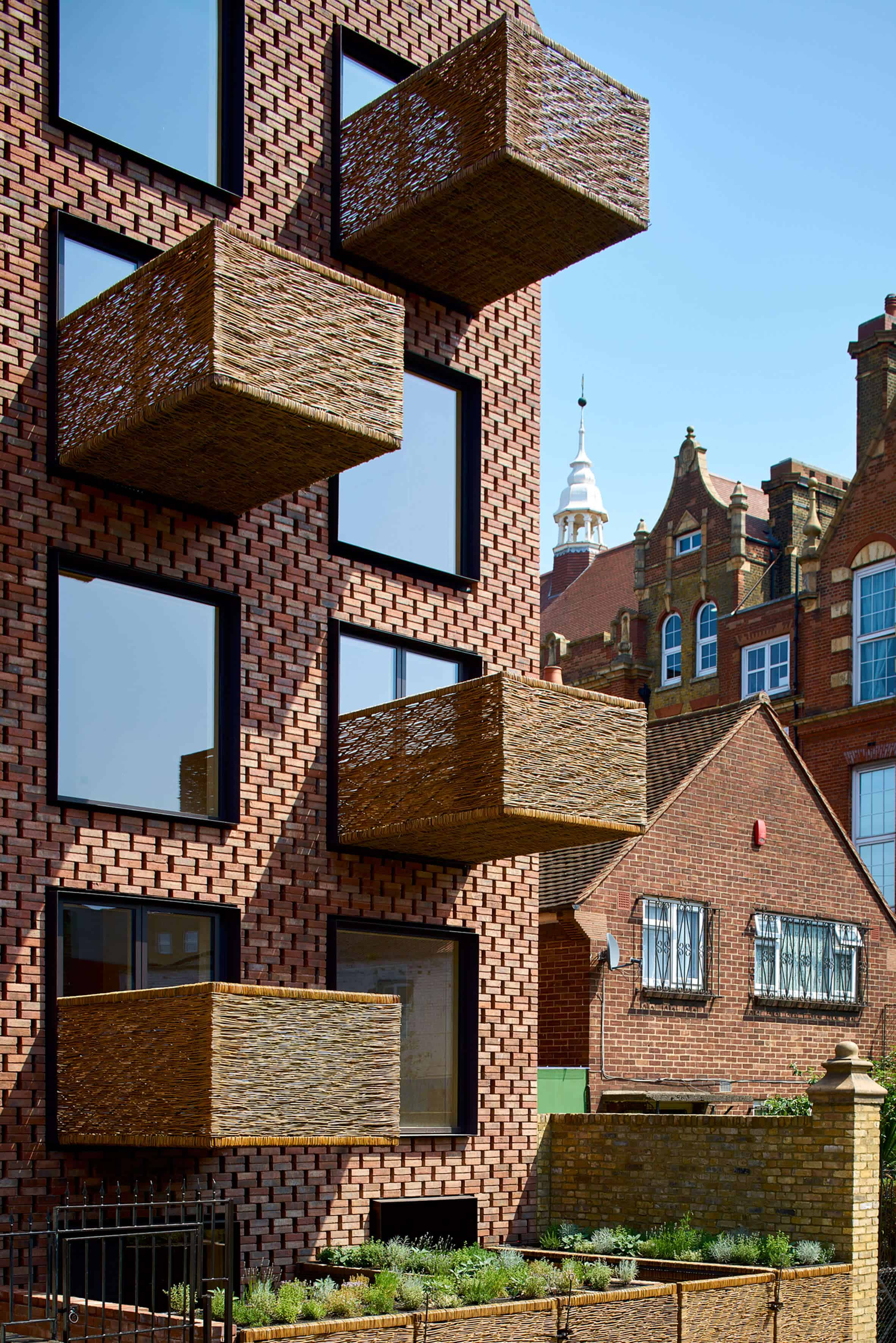 Cross Laminated Timber Wrapped in Brick by Amin Taha Architects 11