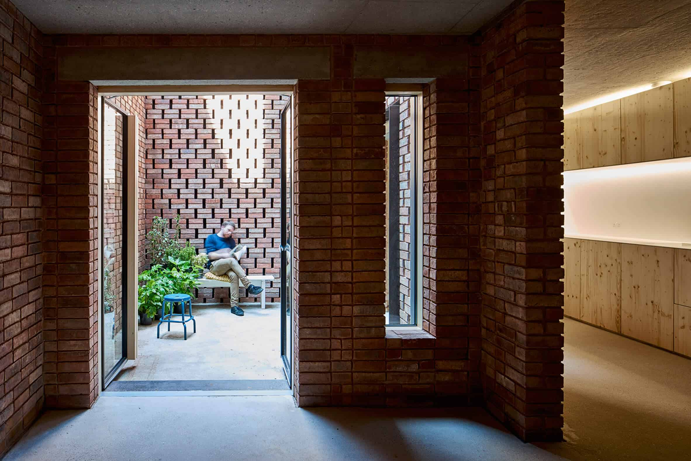 Cross Laminated Timber Wrapped in Brick by Amin Taha Architects 7