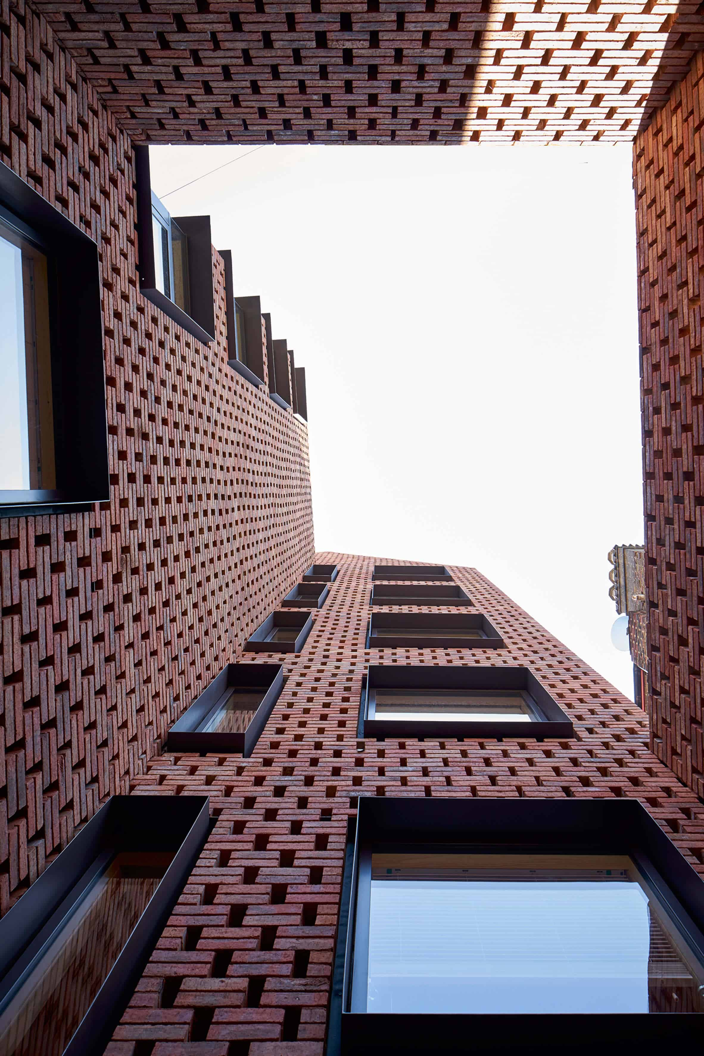 Cross Laminated Timber Wrapped in Brick by Amin Taha Architects 8