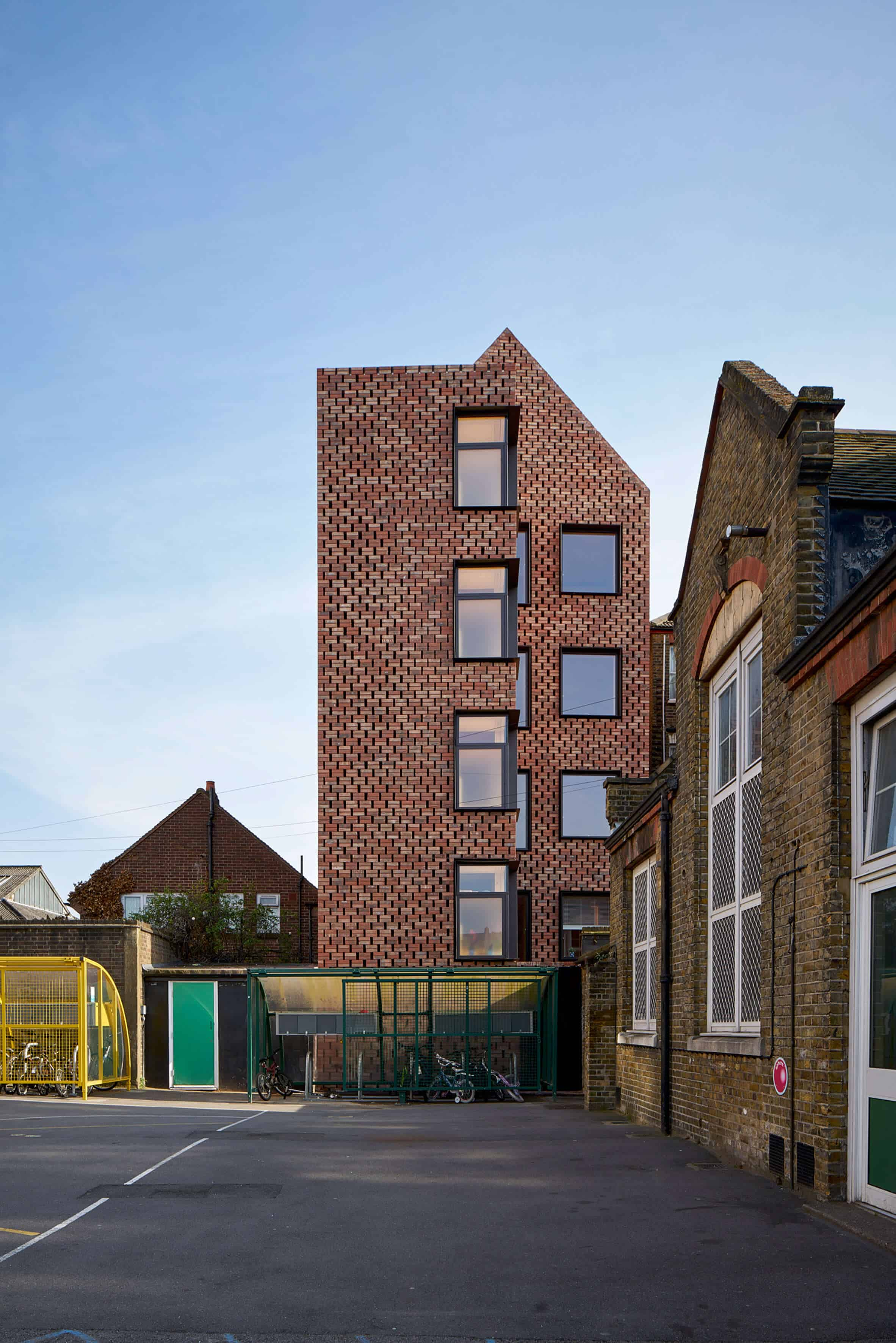 Cross Laminated Timber Wrapped in Brick by Amin Taha Architects 9