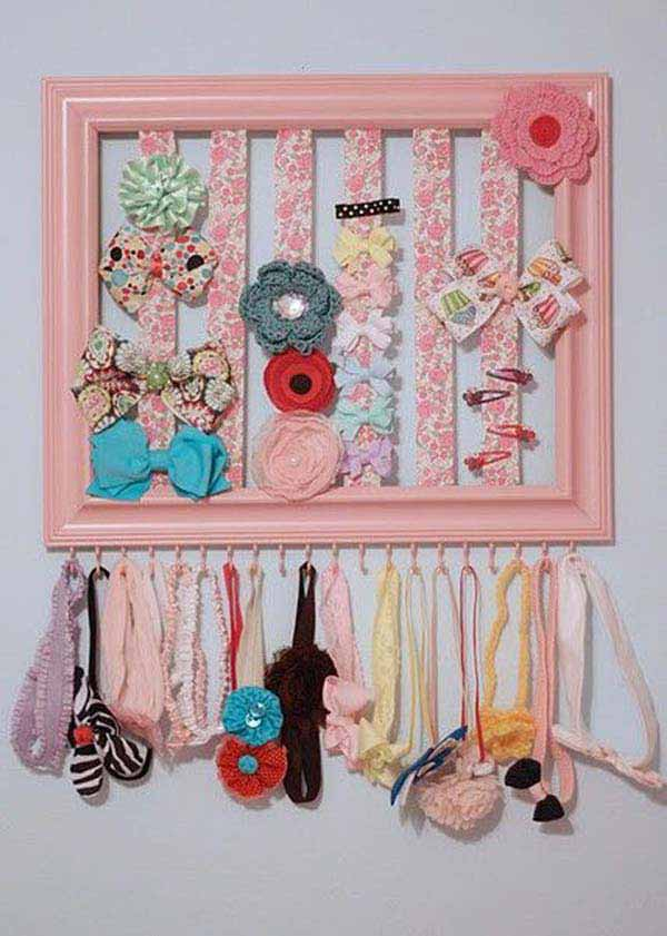 40. FEMININE HAIR CLIPS ORGANIZED IN A PICTURE FRAME