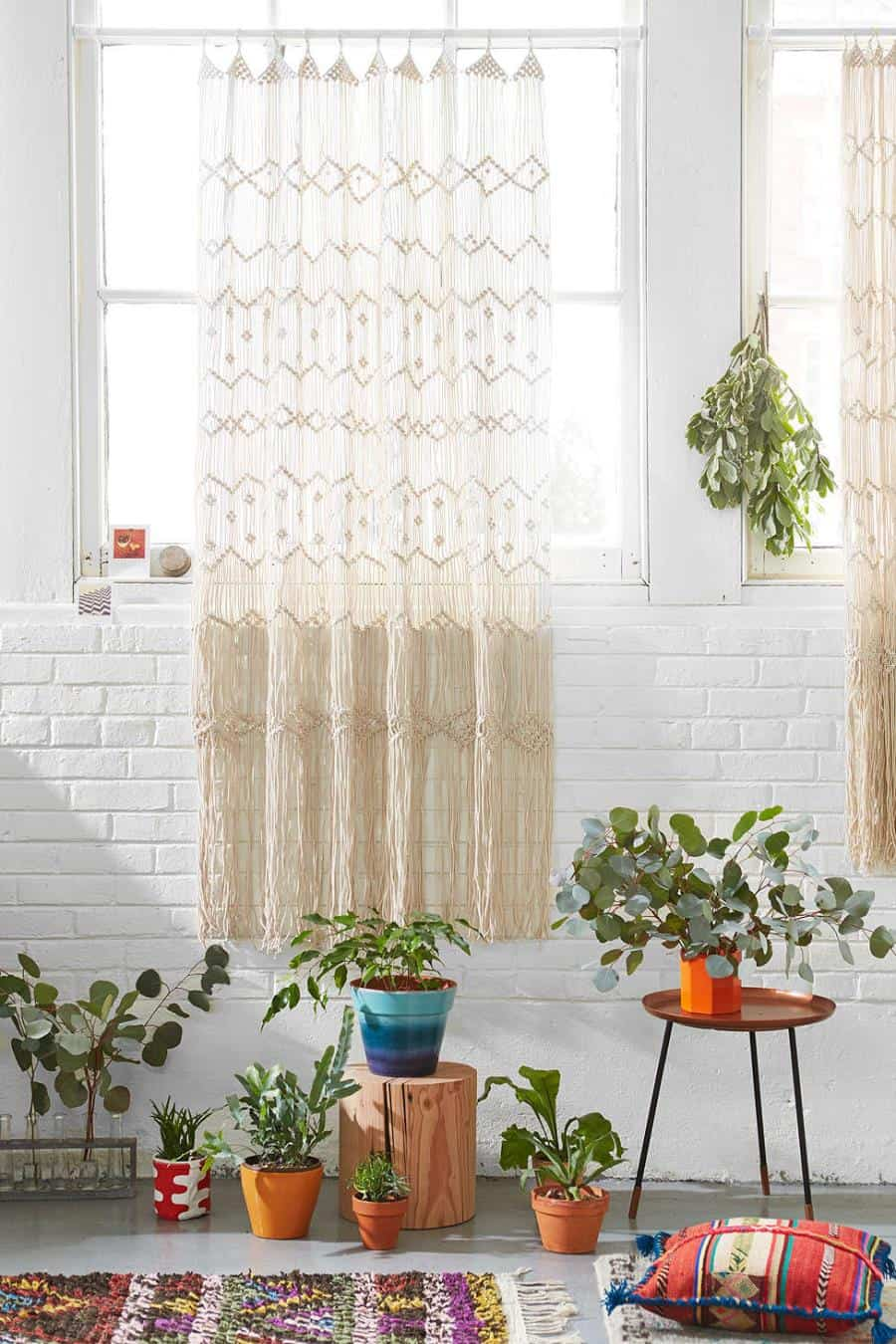 Shabby chic white brick wall surrounded by plants and textiles