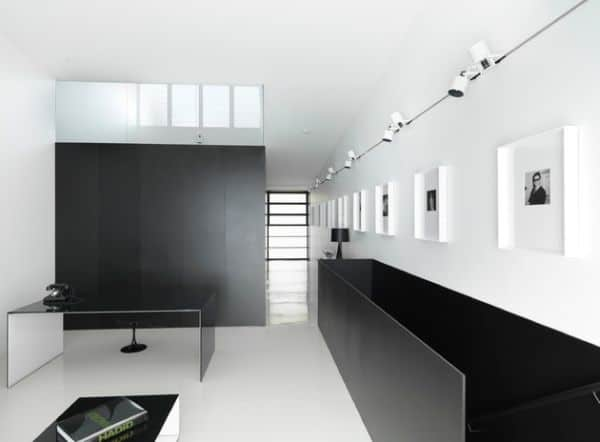 Minimalist Interiors With A Long Gallery Wall Illuminated