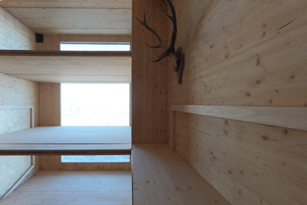 Self-Contained Wooden Shell with a Cantilevered Form in Mount Kanin (7)
