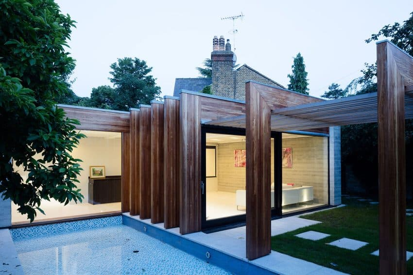 The Contemporary Extension of a Charming Cottage in England 14