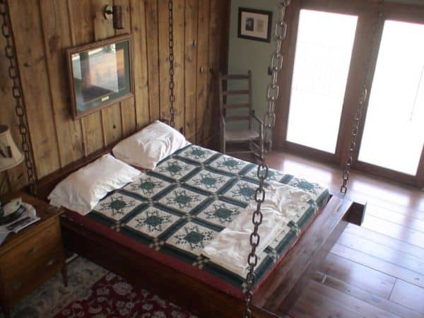 Timber-frame-hanging-bed-for-the-rustic-look